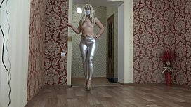 Anal masturbation and foot fetish. A blonde with long legs in shiny leggings seduces and then fucks her juicy PAWG with a dildo.
