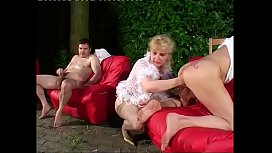 Blonde milf breaks some ass with her fist