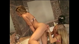 Two gorgeous bitches with long legs lick each other'_s shaved pussies in a beautiful bathroom