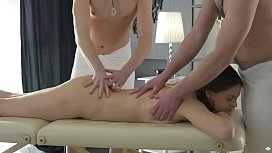 Double penetrated by horny masseurs