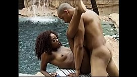 Blak guy comes up from pool to fuck ebony chick with natural boobs