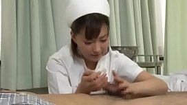 Sexy japanese nurse giving...