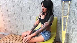 Tattooed Asian model with...