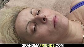 Hot grandma is used by two dudes outdoors