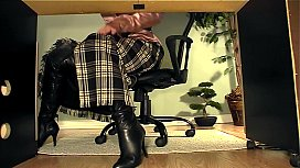 Secretary with boots under...