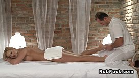 Masseur rubs busty blonde...
