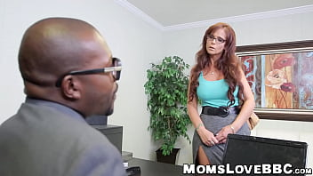 Stunning redhead milf takes two black cocks at the same time