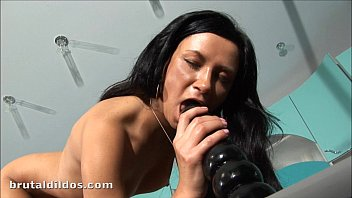 Petite Russian Liana flling her pussy with a brutal dildo