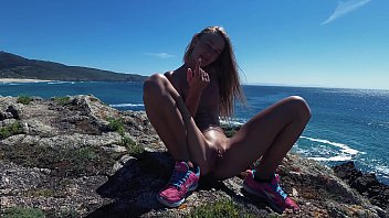 Nudist spain Piss piss travel - cute russian naked nudist girl public pees on the coast of the atlantic ocean in galicia spain