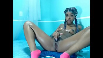 Pig-tailed Ebony Teen with Braces Playing in Her Pussy On Camera