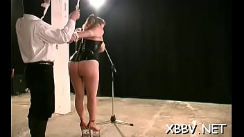 Voluptuous bombshell is playing with a sex tool