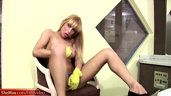 Blonde doll with balls strips and whips out her huge cock