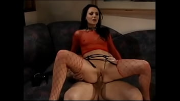 White whore sits on a big white cock and grinds it hard and fast with her pussy