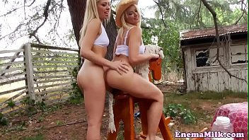 Enema babe dildoed in gaping ass outdoors