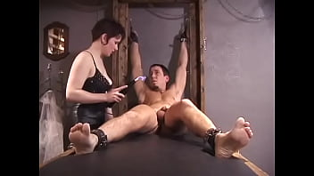 Two slutty sluts in latex costumes tie and dominate a young guy on the table