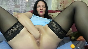 Vaginal fisting, huge zucchini in the vagina, and gaping hole. Chubby milf in stockings stretches he