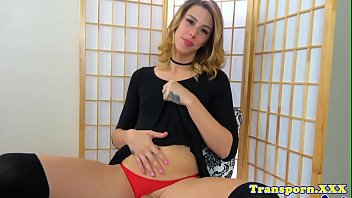 Tranny fingers her ass while toying her cock