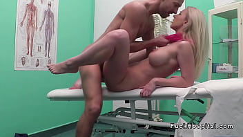 Busty blonde in red scarf bangs doctor