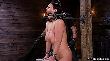 Huge boobs brunette in device bondage