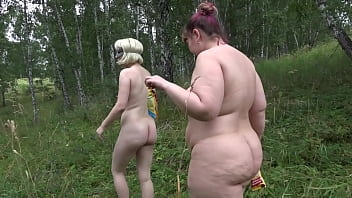Completely naked lesbians with hairy pussies walk in nature and get covered with ice cream. Amateur fetish of two exhibitionists and food fetish outdoor.