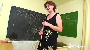 Mature teacher thumbs Mature teacher bangs her student in class