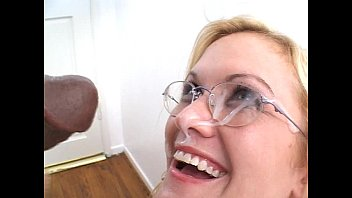 Blonde in glasses gives black guy BJ