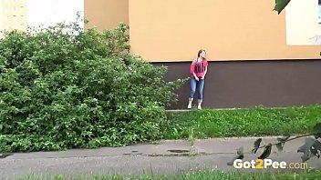Pissing behind bushes Shy and nervous redhead pees outside