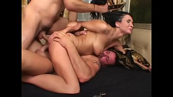 Hot brunette MILF Sandra Kay takes two hard cocks in her pussy and asshole