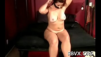Bare slut gets aroused while being tied to the bed