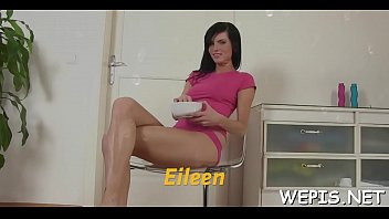 CoverAroused lady Eileen is playing with her big dildo