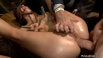 Clamped slut is anal fucked in public