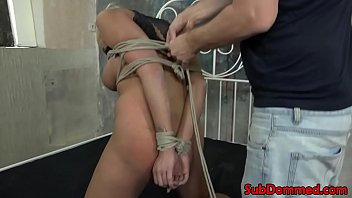 Blonde bdsm sub restrained with ropes by dom