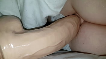 Sleeping wife get fucked by big dildo and fisted
