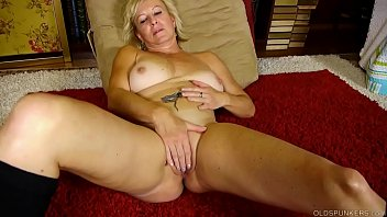 Naughty old spunker talks dirty and fucks her juicy pussy
