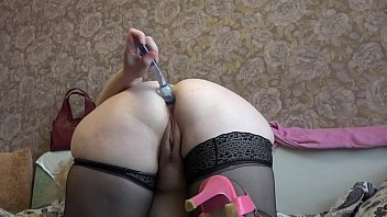 Mature milf in stockings  and with fat ass fuck anal and hairy pussy before webcam.