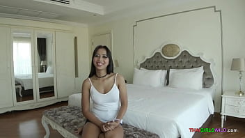 Fresh faced busty Thai whore loves the camera