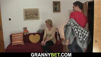 Small tits mature blonde spreads legs for him 6 min