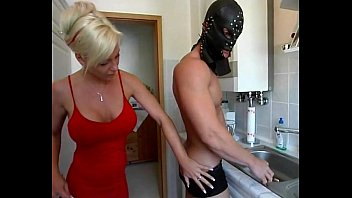 Dominatrix sexy blonde milf having fun in the kitchen