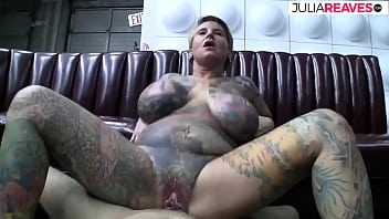 Full body tattooed milf with pussy piercing fucks in front of the video camera