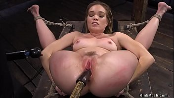 Blonde in glasses toyed in suspension