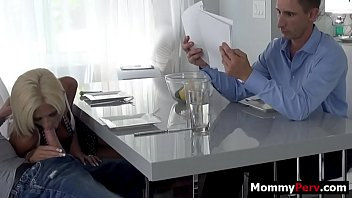 Step mom gives son blowjob next to his busy dad