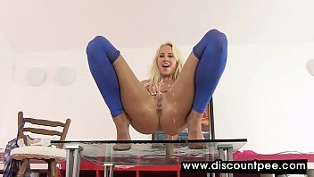Aroused blonde spreads legs and pees on herself
