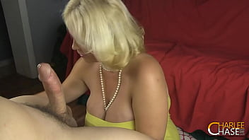 Blonde Cougar Charlee Chase Gives A Handjob With Her Pearl Necklace!