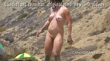 Wow sexy young brunette beauty caught bending over at the nude beach!