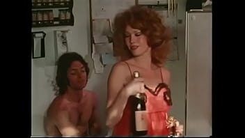 Stuuning hottie with flaming auburn hair Serena prfers to celebrate publication of her first collection of short stories with bottle of cooled champagne, beautiful red ;ingerie and impassioned well hung lover