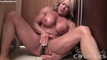 Woman caught with a vibrator Mature female bodybuilder vibes her swollen clit