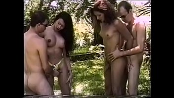 Redhaired and ravenheaded sunburnt t-gils enjoy having nasty foursome action at the  veranda right round the house