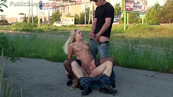 A hot blonde chick is fucked by 2 guys on the street in public sex threesome gangbang