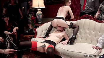 Hot lesbians licking on the sofa at swingers orgy party