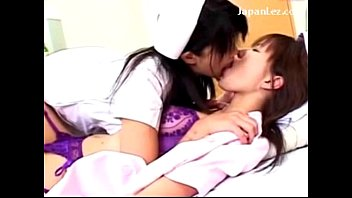 2 Hot Nurses Kissing Making Out On The Bed